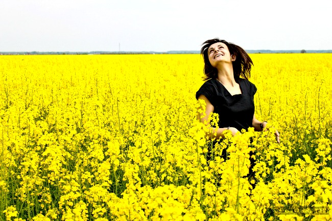 happy_young_woman_in_the_yellow_field_by_matejpaluh-d5r2070